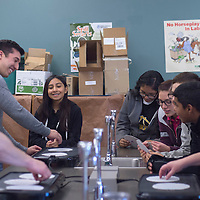Hannah Torres, back left, listens to instructions from Bio Papel Process Engineer Robbie Castillo  at a recycled paper demonstration Wednesday in Kennedy Middle School in Gallup.