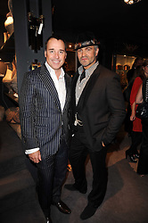 Left to right, DAVID FURNISH and MARTYN LAWRENCE BULLARD at an exclusive viewing of Martyn Lawrence Bullard's furniture at Guinevere Antiques, 578 King's Road, London on 27th September 2010.