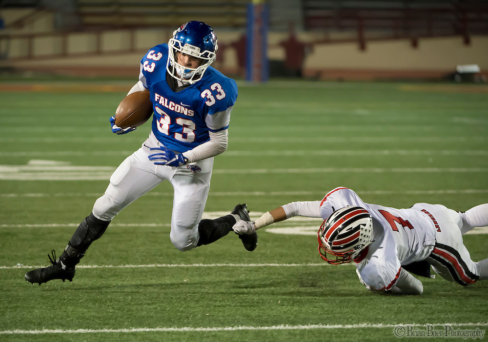 Christian Brothers Falcons Carlos Stahl (33), runs with the ball during the third quarter of the Sac-Joaquin Section Division I football playoff game between the Christian Brothers Falcons and Cordova Lancers at Hughes Stadium,  Friday Nov 11, 2016.<br /> photo by Brian Baer