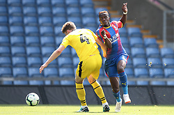 Oxford United's Rob Dickie (left) and Crystal Palace's Wilfired Zaha battle for the ball during a pre season friendly match at The Kassam Stadium, Oxford.