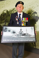 D-Day veteran Radar Operator Leonard Hobbs, 94 poses with an enlarged Royal Mail D-Day commemorative stamp at the National Army Museum in Chelsea, London. The stamps will be released on 2nd June.. London, May 22 2019.
