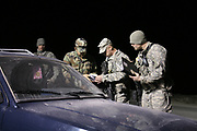 The US Military personnel serving under the Kosovo Force, which is a NATO-led international peacekeeping force in Kosovo, is seen on a night security roadblock patrolling in Llabjan intersection highway towards Pristina the capital on February 27, 2008. (Photo/Vudi Xhymshiti)