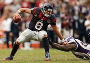 Dec 23, 2012; Houston, TX, USA; Minnesota Vikings defensive tackle Fred Evans (90) sacks Houston Texans quarterback Matt Schaub (8) during the third quarter at Reliant Stadium. The Vikings won 23-6. Mandatory Credit: Thomas Campbell-USA TODAY Sports