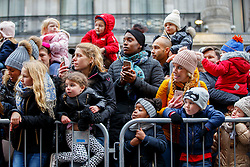 © Licensed to London News Pictures. 20/11/2016. London, UK. Parents and children watch Hamley's Toy Parade marching along Regent Street in London in a colourful extravaganza, with marching bands, dancers and toy vehicles. Photo credit: Tolga Akmen/LNP