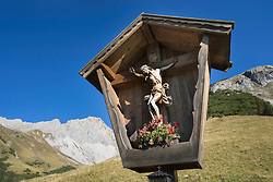 Traditional Jesus crucifix in the mountains, Tyrol, Austria