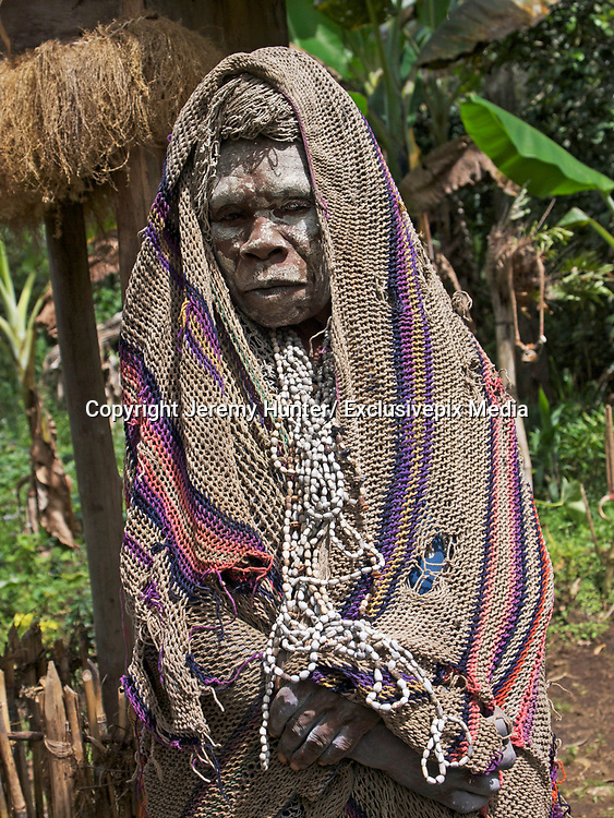 """Papua New Guinea is one of the most untouched lands on Earth.   It's a land without sheep, goats or cattle.<br /> <br /> It's a land where there are no donkeys, horses or mules. A land where there is no recreational sex.<br /> <br /> A land where a new-born girl is called a Shovel, a boy an Axe.  A land of few roads and fewer birth-certificates. <br /> <br /> The Southern Highlands is the land of the Huli - the largest ethnic group, numbering around 55,000 - who have been occupying this remote part of the country for around 1000 years. <br /> <br /> Men and women, husbands and wives, live in separate houses  - as men believe that menstrual blood is the deadliest poison.<br /> <br /> For nine days a month women are caste out to a separate house and during this time the men will not accept any food either touched or cooked by them, nor will they walk on any <br /> <br /> ground trodden by women during their cycle. These Highlanders believe that menstruating women cause sickness and infirmity.<br /> <br /> So couples in the Highlands take great pains to avoid any physical contact with each other, leading completely separate lives, cooking, eating, sleeping and working apart. Sex only <br /> <br /> takes place occasionally - for reproductivity - and it always takes place in the 'garden'. <br /> <br /> Teenage boys go to """"Wig-School"""" - under the tutelage of a Wig-Master;  they live together in isolation from the rest of the community.<br /> Wig-Masters are normally tribal elders who have special powers and are able to cast spells to enable the growth of hair.<br /> <br /> At Wig-School, they learn the fundamentals and rules of Huli traditional customs: growing their hair; collecting feathers; and making armbands.<br /> <br /> One of the rules of Huli culture is that boys live with their mothers until they are seven or eight years old, then they live with their fathers to learn skills like hunting with bows and arrows, building mud walls and making houses.<br /> <br /> Wh"""