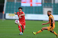 George B Williams of Milton Keynes Dons in action (l).EFL cup, 1st round match, Newport county v Milton Keynes Dons at Rodney Parade in Newport, South Wales on Tuesday 9th August 2016.<br /> pic by Andrew Orchard, Andrew Orchard sports photography.