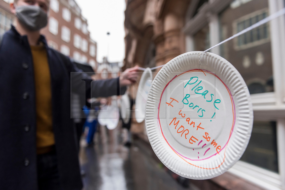© Licensed to London News Pictures. 29/10/2020. LONDON, UK.  People take part in a protest outside the Department for Education in Westminster by affixing paper plates with messages directed at the UK government to reconsider their recent decision not to provide free school meals until Easter 2021.   Footballer Marcus Rashford's campaign to provide school meals continues to receive public and business support.  Photo credit: Stephen Chung/LNP