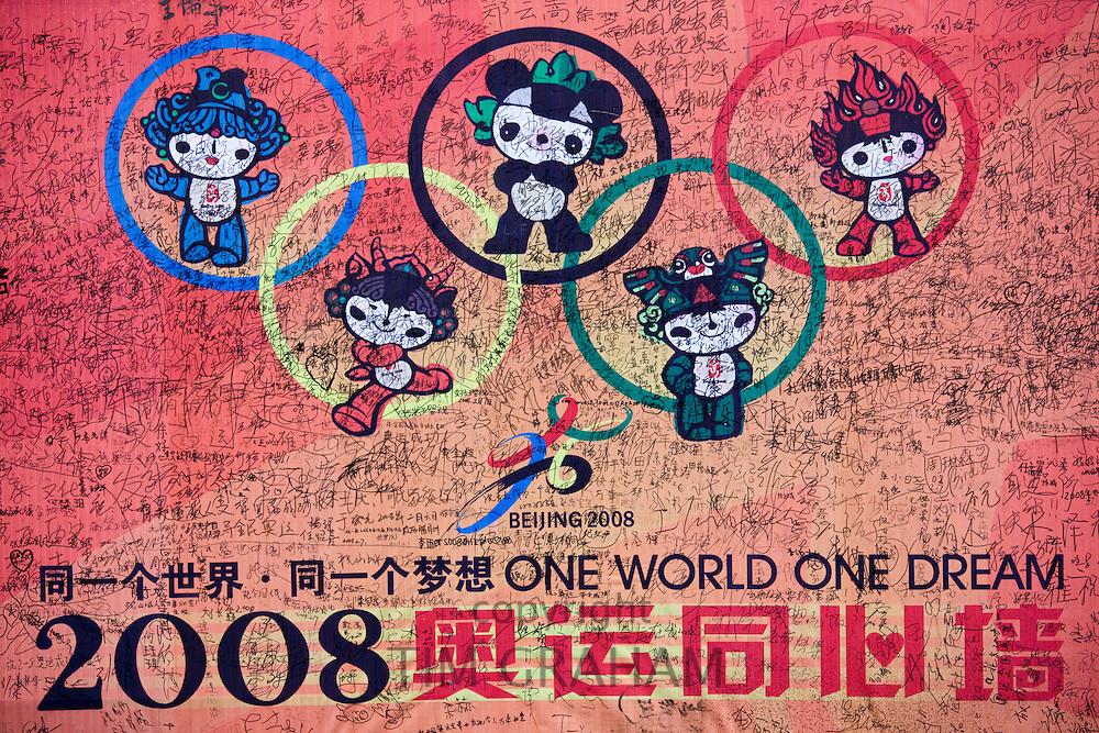 Goodwill messages on 2008 Beijing Olympics poster with Fuwa mascots Bei Jing Huan Ying Ni in Chongqing, China