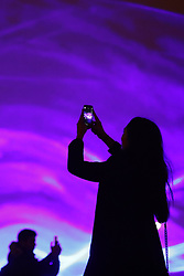 © Licensed to London News Pictures. 17/01/2018. London, UK. Visitors to Granary Square in King's Cross take phone photographs of a laser and smoke light show entitled 'Waterlicht' by Daan Roosegaarde during the Lumiere London festival rehearsals. Running from 18th-21st January 2018 more than 50 artworks​ are transforming the capital's streets, buildings and public spaces into an immersive nocturnal art exhibition of light and sound. Locations include King's Cross, Fitzrovia, Mayfair, West End, Trafalgar Square, Westminster, Victoria, South Bank and Waterloo. Photo credit: Peter Macdiarmid/LNP