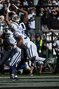 Oakland Raiders wide receiver Seth Roberts (10) reaches over the Indianapolis Colts defense for a reception at Oakland Coliseum in Oakland, Calif., on December 24, 2016. (Stan Olszewski/Special to S.F. Examiner)
