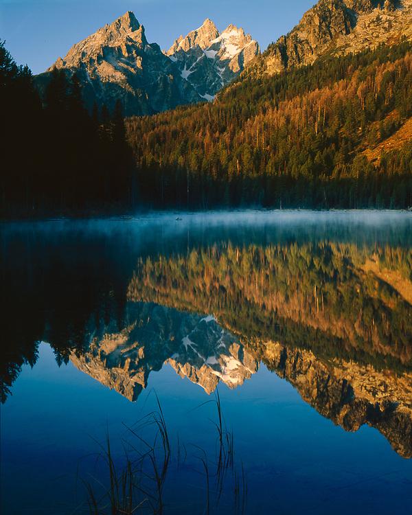 Grand Teton and Mount Teewinot reflect on Lake. morning kight, Grand Teton National Park, WY., USA