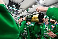 Miha Zajc of HK SZ Olimpija drinking champagne after 3rd leg of ic hockey game between HK SZ Olimpija Ljubljana and Asiago Hockey in Final of Alps Hockey League 2020/21, on April 24, 2021 in Hala Tivoli, Ljubljana, Slovenia. Photo by Matic Klansek Velej / Sportida