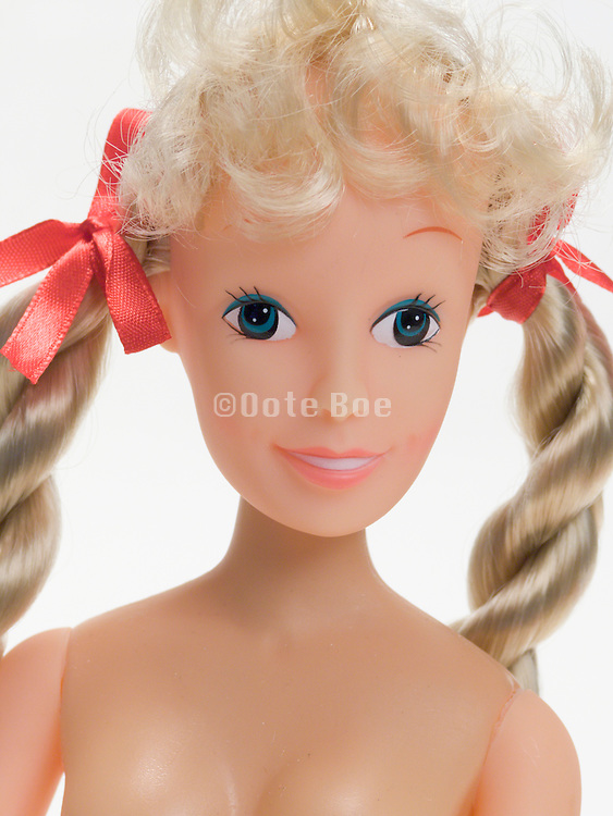 close up of a blonde haired doll