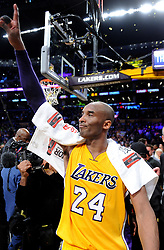 File photo of The Los Angeles Lakers' Kobe Bryant salutes the crowd after his final game, on April 13, 2016, at Staples Center in Los Angeles. (Wally Skalij/Los Angeles Times/TNS/ABACAPRESS.COM)
