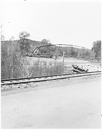 """View of steel automobile bridge over Dolores River south of town.  RGS mainline is in foreground.<br /> RGS    <br /> In book """"Rio Grande Southern II, The: An Ultimate Pictorial Study"""" page 315"""