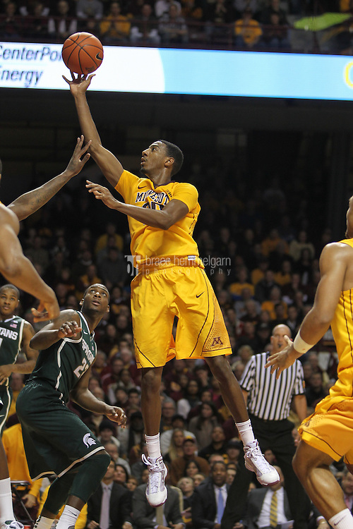 Dec 31, 2012; Minneapolis, MN, USA; Minnesota Golden Gophers guard Austin Hollins (20) shoots during the second half against the Michigan State Spartans at Williams Arena. Minnesota defeated Michigan State 76-63. Mandatory Credit: Brace Hemmelgarn