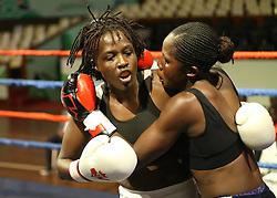 Judy Nyaguthi (L) of Kenya and Consolata Msanda of Kenya exchange blows during their Mac Series Professional Boxing Bonaza at Safaricom Indoor Arena in Nairobi on November 5, 2016. Judy won Photo/Fredrick Onyango/www.pic-centre.com (KEN)