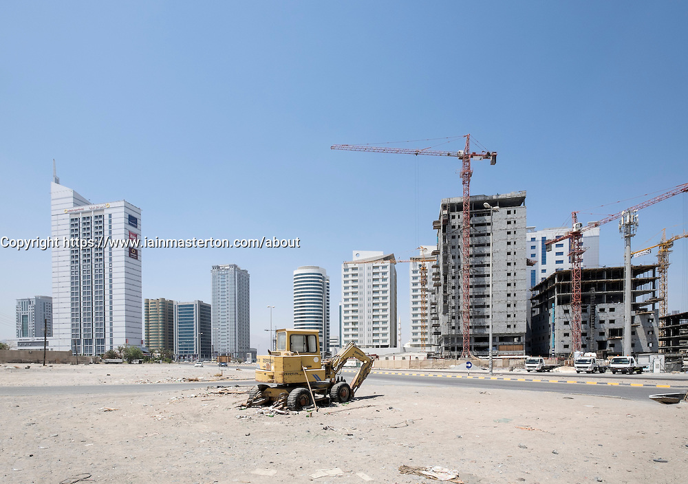 View of modern office buildings and construction site  in Fujairah city in United Arab Emirates