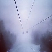Gondolas descent in a thick fog from the Laura Cross-Country Ski and Biathlon Center on Monday, Feb. 17, 2014. Sochigrams during the Winter Olympics in Sochi, Russia with an iPhone and Instagram. (Brian Cassella/Chicago Tribune) B583527420Z.1 <br /> ....OUTSIDE TRIBUNE CO.- NO MAGS,  NO SALES, NO INTERNET, NO TV, CHICAGO OUT, NO DIGITAL MANIPULATION...