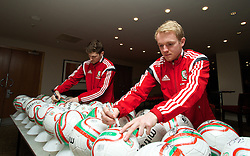 CARDIFF, WALES - Tuesday, March 4, 2014: Wales' Ben Davies and Jonathan Williams during a signing session at the St. David's Hotel ahead of the International Friendly against Iceland. (Pic by David Rawcliffe/Propaganda)  CARDIFF, WALES - Tuesday, March 4, 2014: Wales' xxxx during a training session at the Cardiff City Stadium ahead of the International Friendly against Iceland. (Pic by David Rawcliffe/Propaganda)
