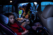 U.S. Navy veteran Joaquin Antonio Sotelo Tarin, 37, places his 10-month-old son, Noah Ethan Sotelo, and three-year-old stepdaughter, Areli Rodriguez, into his family's pickup truck outside his home in Newman, California, before heading to a court hearing in Merced Superior Court on Thursday, February 14, 2019.<br /> <br /> A public defender representing Sotelo during his legal proceedings for a domestic violence conviction failed to inform him about the immigration consequences in pleading no contest to the aggravated felony charge in 2014. Sotelo was sentenced to three years in prison and was released early for good behavior after serving 18 months. Upon his release from prison in 2015, Sotelo was transferred to immigration custody where he was detained for 15 months until an immigration judge released him on bond allowing him to be with his family as he continues to fight his immigration case.<br /> <br /> During Sotelo's court hearing in February 2019, Merced County Judge Jeanne Schechter ruled that he was not made aware by his attorney of the immigration consequences when he pleaded no contest to the domestic violence charge. An agreement was reached between Sotelo's attorneys and District Attorney prosecutors that re-sentenced Sotelo to 364-day consecutive jail terms, which avoids a previous aggravated felony charge that had made him deportable by I.C.E. agents.<br /> <br /> Sotelo must still appear in federal immigration court on December 12, where he may still be sought after for deportation due to previous state felony convictions.
