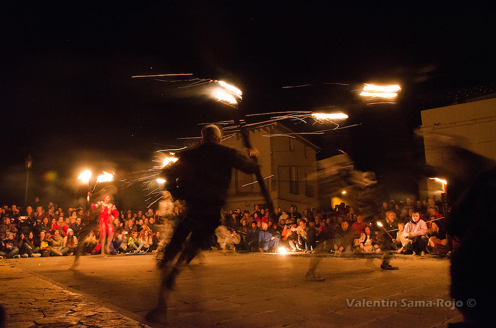 'Contradanceros' dancing carrying torches during the performance of Cetina's Contradanza honoring St. Juan Lorenzo.