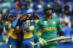 Sri Lanka's Lasith Malinga celebrates taking the wicket of Pakistan's Shoaib Malik during the ICC Champions Trophy, Group B match at Cardiff Wales Stadium.