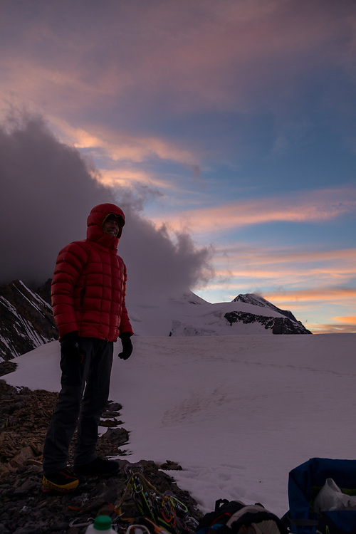 Simon Parsons at last light with Mt Robson obscured by clouds in the background.