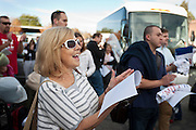 Diane Davey, left, screams in support of Mitt Romney before getting on a bus to Las Vegas to get out the vote at a pro-Romney rally and volunteer sendoff, Friday, Nov. 2, 2012.