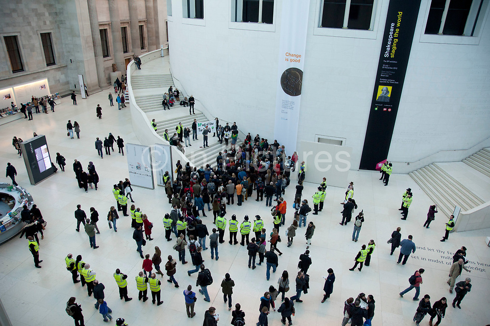 London, UK. Sunday 18th November 2012. Reclaim Shakespeare Company flashmob demonstrating in the British Museum's Great Court against BP's (British Petroleum) sponsorship of the arts. Oil giant BP has a long-running financial relationship with the British Museum. The museum's current 'Shakespeare: Staging the World' exhibition is sponsored by BP.  Despite the company's decision to go into the 'world's most destructive project' – the Tar Sands, the devastating Deepwater Horizon spill, and its eyeing-up of the vulnerable Arctic.