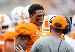 Sep 1, 2018; Charlotte, NC, USA; Tennessee Volunteers quarterback Jarrett Guarantano (2) talks with an assistant during the second quarter against the West Virginia Mountaineers at Bank of America Stadium. Mandatory Credit: Ben Queen-USA TODAY Sports