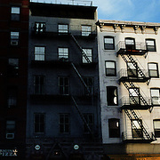 A Panoramic view of Downtown Manhattan in the late afternoon sunlight showing a typical fire escape on the outside of the building. Manhattan, New York, USA. 23rd July 2011. Photo Tim Clayton