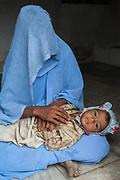 Rajasthani village woman and child. Pushkar, Rajasthan. INDIA