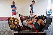 Iris Slappendel past nog even wat aanpassingen in de fiets. Het Human Power Team Delft en Amsterdam (HPT), dat bestaat uit studenten van de TU Delft en de VU Amsterdam, is in Senftenberg voor een poging het laagland sprintrecord te verbreken op de Dekrabaan. In september wil het Human Power Team Delft en Amsterdam, dat bestaat uit studenten van de TU Delft en de VU Amsterdam, tijdens de World Human Powered Speed Challenge in Nevada een poging doen het wereldrecord snelfietsen voor vrouwen te verbreken met de VeloX 7, een gestroomlijnde ligfiets. Het record is met 121,44 km/h sinds 2009 in handen van de Francaise Barbara Buatois. De Canadees Todd Reichert is de snelste man met 144,17 km/h sinds 2016.<br /> <br /> The Human Power Team is in Senftenberg, Germany to race at the Dekra track as a preparation for the races in America. With the VeloX 7, a special recumbent bike, the Human Power Team Delft and Amsterdam, consisting of students of the TU Delft and the VU Amsterdam, also wants to set a new woman's world record cycling in September at the World Human Powered Speed Challenge in Nevada. The current speed record is 121,44 km/h, set in 2009 by Barbara Buatois. The fastest man is Todd Reichert with 144,17 km/h.