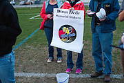 Students and friends of German exchange student, Diren Dede, who was slain on April 27, 2014, sell stickers to raise money for funeral expenses for Dede's family at Dede's vigil on May 2, 2014 at the Fort Missoula soccer field where Dede played.