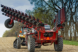 24 row seed drill single seed planting implement allows seeding of grain fields without prior tilling to provide both economical and ecological benefits