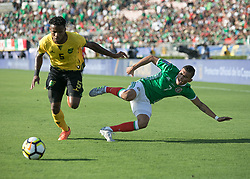July 23, 2017 - Pasadena, California, U.S - Rodolfo Pizarro #15 of Mexico and Damion Lowe #3 of Jamaica battle for the ball during their Gold Cup Semifinal game at the Rose Bowl in Pasadena, California on Sunday July 23, 2017. Jamaica defeats Mexico, 1-0. (Credit Image: © Prensa Internacional via ZUMA Wire)