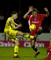 Photo: Alan Crowhurst.<br /> Swindon Town v Bury FC. Coca Cola League 2. 25/11/2006. Bury's Mark Pugh (L) challenges with Andy Nicholas.