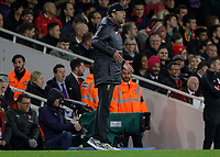 Football - 2018 / 2019 Premier League - Arsenal vs. Liverpool<br /> <br /> Jurgen Klopp, manager of Liverpool FC,  on tip toes as his side go close to scoring at The Emirates.<br /> <br /> COLORSPORT/DANIEL BEARHAM