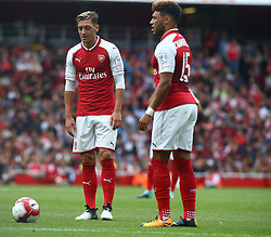 July 30, 2017 - London, England, United Kingdom - L-R Arsenal's Mesut Ozil and Arsenal's Alex Oxlade-Chamberlain.during Emirates Cup match between Arsenal  against Savilla FC   at Emirates Stadium on July 30, 2017 in London, England. (Credit Image: © Kieran Galvin/NurPhoto via ZUMA Press)