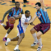 Anadolu Efes's Dontaye Draper (C) and Trabzonspor's Demarquis D'Angelo Bost (L) Andrija Stipanovic (R) during their Turkish Basketball League Play Off Semi Final round 1 match Anadolu Efes between Trabzonspor at Abdi Ipekci Arena in Istanbul Turkey on Friday 29 May 2015. Photo by Aykut AKICI/TURKPIX