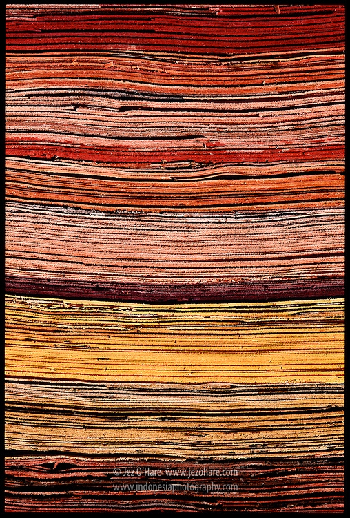 Colorful slices of tropical hardwood before being glued and pressed into plywood, East Kalimantan, Indonesia.