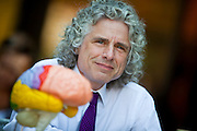 (Cambridge, MA - September 2, 2009) Features around Harvard University Campus during the first day of classes for fall semester 2009.  Steven Pinker, Johnstone Family Professor of Psychology at Harvard takes a brake at Au Bon Pain (ABP) in the square, with the model of a brain.  Staff Photo Justin Ide/Harvard University News Office