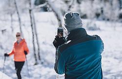 THEMENBILD - ein Mann fotografiert mit dem Handy eine Frau mit Wanderstöcken in einer winterlichen Landschaft. Das Naturdenkmal Wasenmoos lädt auch im Winter zu ausgedehnten Wanderungen in den Kitzbüheler Alpen ein, aufgenommen am 21. November 2020 in Mittersill, Oesterreich // a man uses his mobile phone to photograph a woman with walking sticks in a winter landscape. The natural monument Wasenmoos invites you also in winter to extensive hikes in the Kitzbüheler Alps, in Mittersill, Austria on 2020/11/21. EXPA Pictures © 2020, PhotoCredit: EXPA/Stefanie Oberhauser