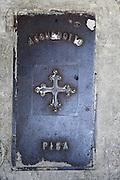 Old manhole cover,  Pisa, Tuscany, Italy