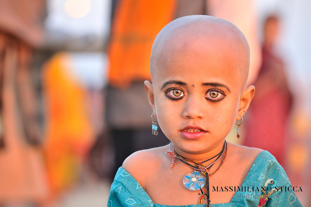 """Both Hindu boys and girls undergo a ritual at about four years old in which they have their heads shaved. Hair is seen as an adornment so by shaving the head, the child confronts his or her bare ego. It teaches humblenessand devotion. Children with shaved heads are seen as innocent and holy and are treated with great respect. """".Shaving the head can also be seen as an act of humility for adults. For example, at the Kumbha Mela the first ritual observed by most pilgrims is the mundana ceremony, the shaving of the head. Hair is considered the symbol of vanity, and in order to receive the full benefits of a pilgrimage to a holy place, one must first give up vanity. Thus, the pilgrims believe that the hair should be shaven from the head in a gesture of surrender and humility..Hindu men have their heads shaven only when somebody elderly dies in the house and women were shaven_headed only when they are widows and not otherwise."""
