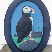 A puffin sign in Beaumaris on the island of Anglesey of the north coast of Wales, UK. Beaumaris is famous for the puffins that live on islands nearby.