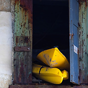 Kayaks in a storage room under a beach front home in Malibu, California.