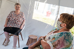 Women laugh as a daughter visits her mother in a bubble at Fondation Shadet Vercoustre nursing home on May 27, 2020 in Bourbourg near Gravelines, France, where a double entry bubble has been installed to allow visits without risk of contamination, as part of a prophylactic measure against the spread of the Covid-19 disease caused by the novel coronavirus. Relatives and residents each enter the tent through a different entrance to find themselves in the same room, separated by a transparent plastic canvas. These bubbles were originally designed for tourism by the company. Photo by Julie Sebadelha/ABACAPRESS.COM